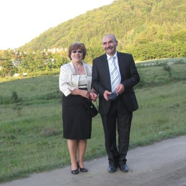 Crista's mum and dad going to a wedding; they're dressed for the church ceremony; Dad didn't change, but mum just changed shoes to something shinier and changed accessories